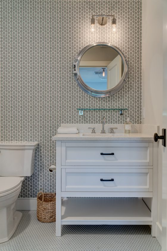 Bathroom vanity with porthole-syle mirror above