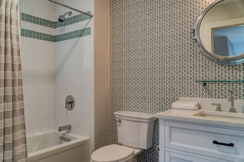 Tub with tiled walls