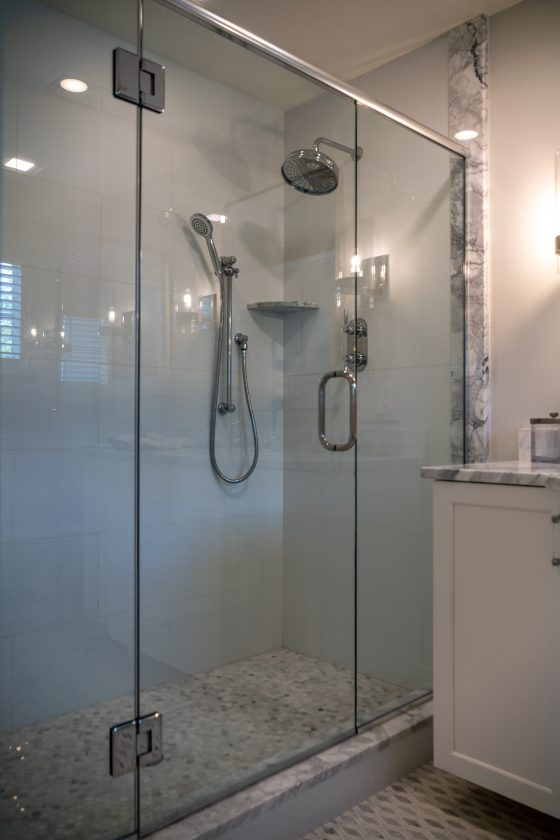 Glass enclosed walk-in tiled shower