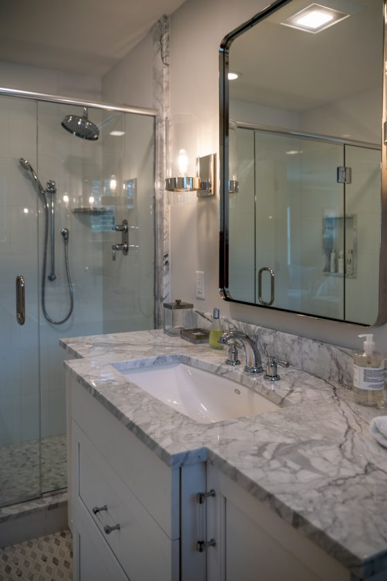 Bathroom vanity, mirror, and shower