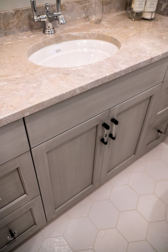 Bathroom vanity and octagon tiled floor
