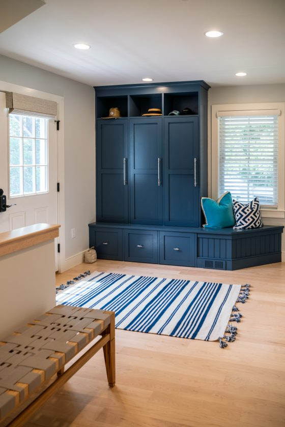 Entryway with cupboards and benches