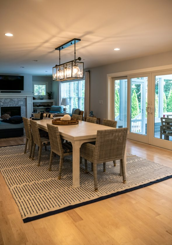 Dining area with French doors opening into screen-in porch